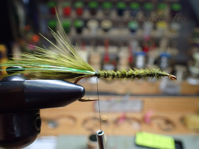 If you are using flash like in the Low Water Wooly Bugger you can pull it back and take a few wraps to secure it in place.