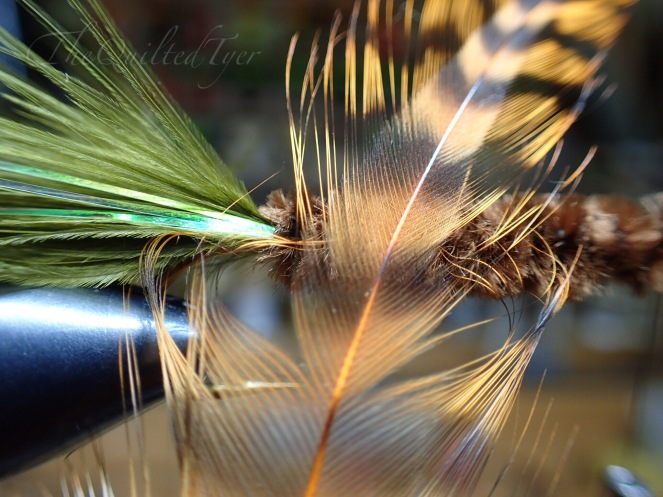 Grab your hackle and select one that has fibers which are just about twice as long.. as the width of your hook gap.