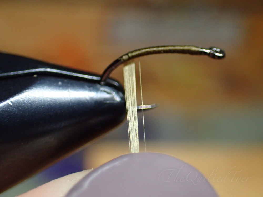 Run your fingernail down the strands towards the bobbin to smooth out the strands.