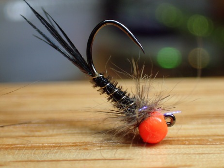 Orange beaded Jig
