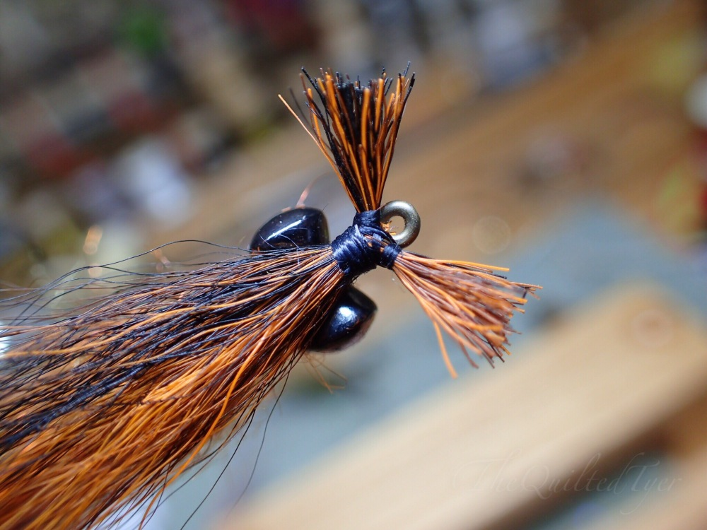 Once you have completed securing the bucktail you can whip finish right in-front of the barbell eyes/behind tail and cut your thread