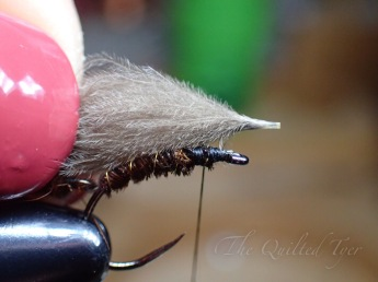 Hold your puff over the hook shank and measure to about the shank in length..